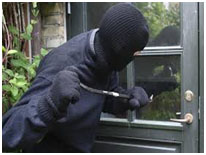 Robber breaking into a home